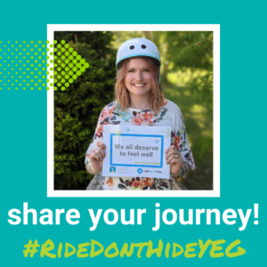 A picture of a person wearing a skateboarding helmet and holding a sign that reads 'Everyone deserves to feel well'. Text beneath the image reads 'Share your journey! #RideDontHideYEG'